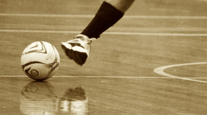 futsal-ball-and-player-on-court